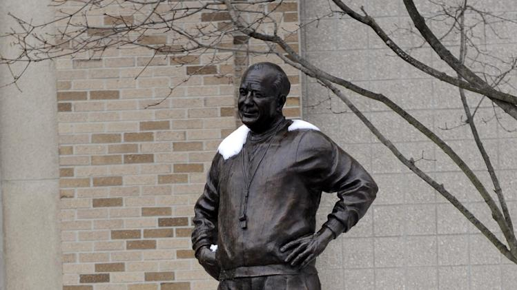 In this Dec. 27, 2012, photo, a statue of legendary Notre Dame football coach Knute Rockne is displayed outside the football stadium on the campus of the University of Notre Dame in South Bend, Ind. (AP Photo/Joe Raymond)
