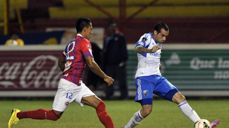 Romero of Canada's Montreal Impact controls the ball past Mendoza of El Salvador's Club Deportivo FAS during their CONCACAF Champions League soccer match at the Cuscatlan stadium in San Salvador