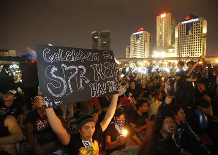 A demonstrator holds up a placard during protest against the recent election results in Petaling Jaya