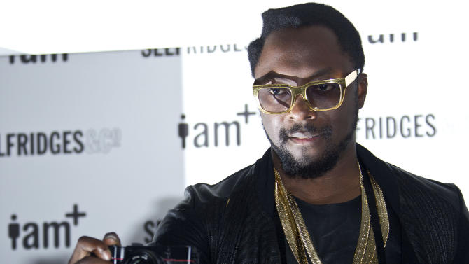Musician and entrepreneur will.i.am poses with his new i.am+foto camera accessory at the Fashion Retail Academy in central London, Wednesday Nov. 28, 2012. The design combines the form and function of a camera with an iPhone. (Photo by Joel Ryan/Invision/AP)
