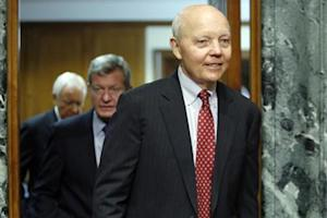 Koskinen returns from a break with Baucus and Hatch to resume testimony before a Senate Finance Committee confirmation hearing on his nomination to be commissioner of the Internal Revenue Service (IRS) on the Capitol Hill in Washington