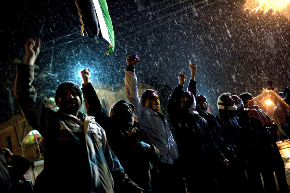 Free Syrian Army supporters chant anti government slogans under snowfall on the outskirts of Idlib , north Syria,  Wednesday, Feb. 29, 2012. (AP Photo/Rodrigo Abd)