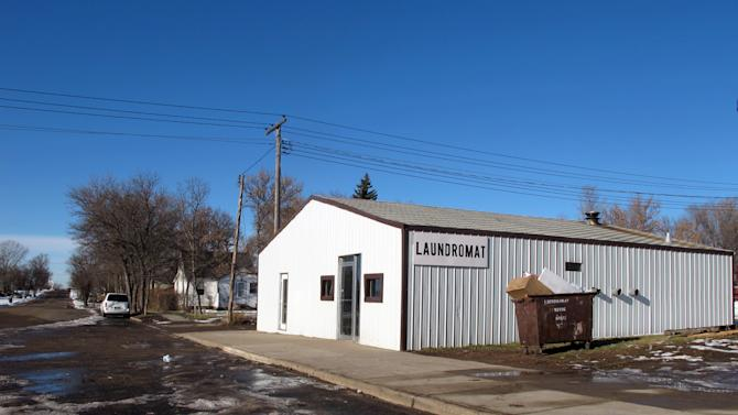 This laundromat located in Pashall, N.D, is near the location where a New Town, N.D., man killed himself with a knife Sunday, Nov. 18, 2012. The man is considered a person of interest in the Sunday shooting death of a woman and three of her granchildren in New Town, N.D., on an American Indian reservation called Fort Berthold. Martha Johnson, 64, and three of her grandchildren were gunned down in the home Sunday afternoon. (AP Photo/The Bismarck Tribune, Lauren Donovan)