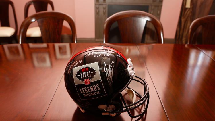A detail view of a NFLPA Legends autographed helmet sits on a table during the NFLPA Legends Brunch at the National World War II Memorial Museum on Sunday February 3, 2013 in New Orleans, Louisiana. (Aaron M. Sprecher/AP Images for NFLPA)