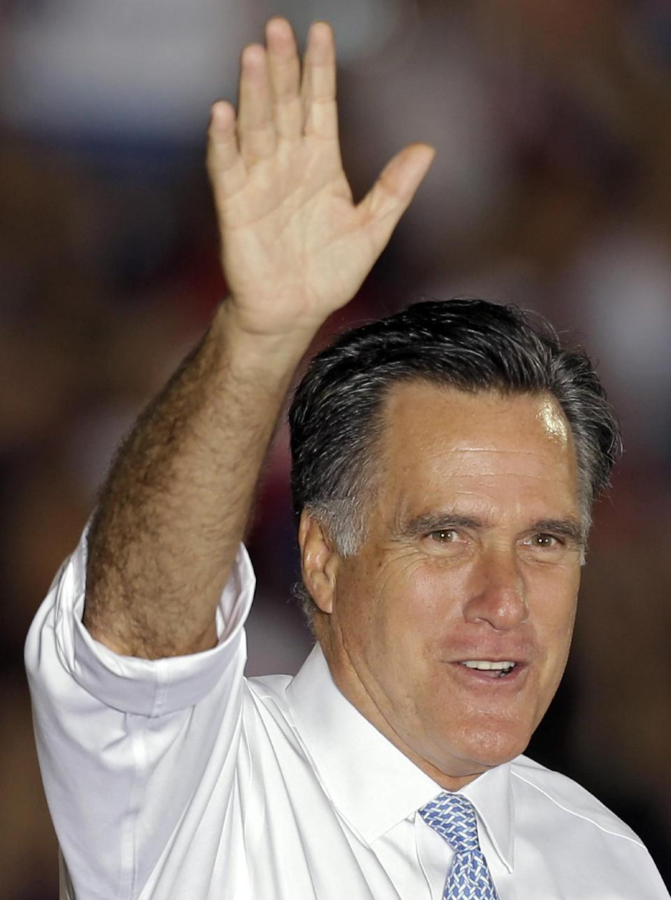 Republican presidential candidate and former Massachusetts Gov. Mitt Romney waves to supporters after a campaign speech Saturday, Oct. 27, 2012, in Land O' Lakes, Fla. (AP Photo/Chris O'Meara)