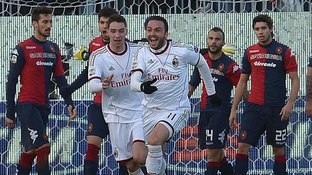 AC Milan's forward Giampaolo Pazzini (C) celebrates after scoring against Cagliari (AFP)