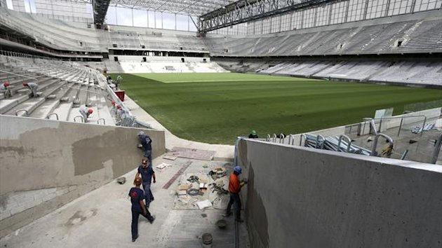 Workers are pictured inside the Arena da Baixada stadium (Reuters)