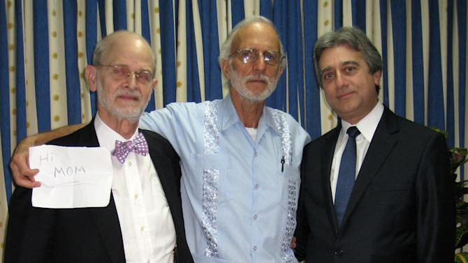In this photo released by Finlay Military Hospital, jailed American Alan Gross, center, holds a sign as he poses for a photo with Rabbi Elie Abadie, right, and U.S. lawyer James L.Berenthal at the Finlay military hospital in Havana, Cuba, Tuesday, Nov. 27, 2012. Gross was imprisoned in December 2009. At the time he was working as a subcontractor on a democracy-building project funded by the U.S. Agency for International Development. (AP Photo/Finlay Military Hospital)