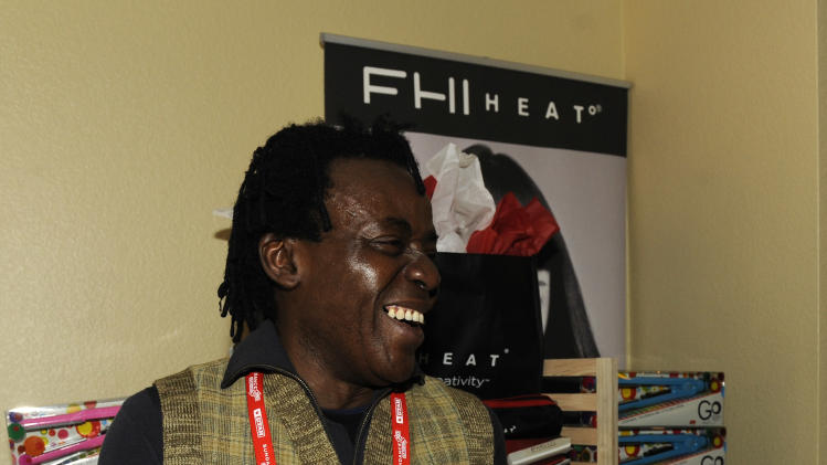 Director John Akomfra visits the FHI HEAT hair tools booth at the Fender Music lodge during the Sundance Film Festival on Sunday, Jan. 20, 2013, in Park City, Utah. (Photo by Jack Dempsey/Invision for Fender/AP Images)