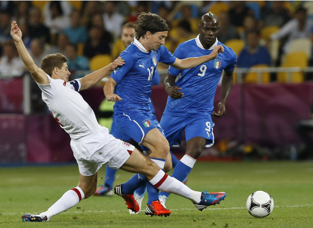 England's Steven Gerrard tries to stop Italy's Riccardo Montolivo during the Euro 2012 soccer championship quarterfinal match between England and Italy in Kiev, Ukraine, Sunday, June 24, 2012. (AP Pho