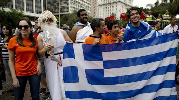 Fans of the Greek national soccer team pose for a picture at the FIFA Fan Fest, before a round of 16 World Cup soccer match against Costa Rica, in Sao Paulo, Brazil, Sunday, June 29, 2014