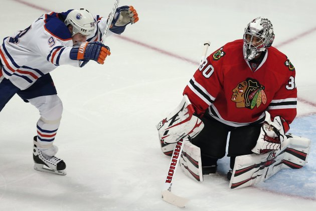 Edmonton Oilers' Ryan Smyth celebrates his team's goal scored on Chicago Blackhawks' Ray Emery during their NHL hockey game in Chicago