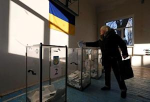 A woman casts a ballot during a parliamentary election…