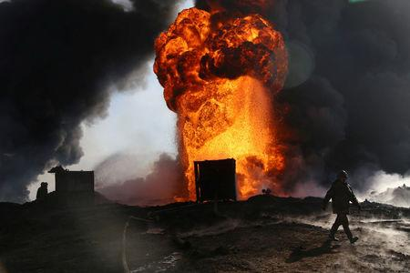 Iraqi sheep, locals, environment suffer Islamic State oil fires
