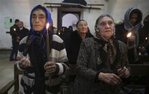 File photo shows Syriac Christians from Turkey and Syria attending a mass at the Mort Shmuni Syriac Orthodox Church in the town of Midyat