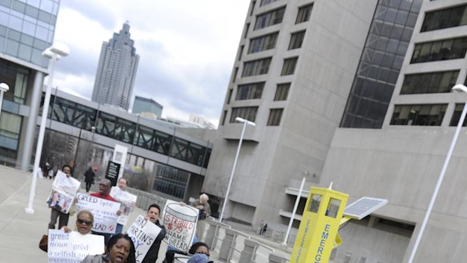 Protesters from the Atlanta Drug Pricing Forum demonstrate against high drug prices, outside the Conference on Retroviruses and Opportunistic Infections on Tuesday, March 5, 2013, in Atlanta. AIDS Healthcare Foundation has joined with Citywide Project and HCV Coalition for the Cure to host the two day forum underway in Decatur, Ga., being held concurrently with CROI .  (John Amis/AP Images for AIDS Healthcare Foundation)