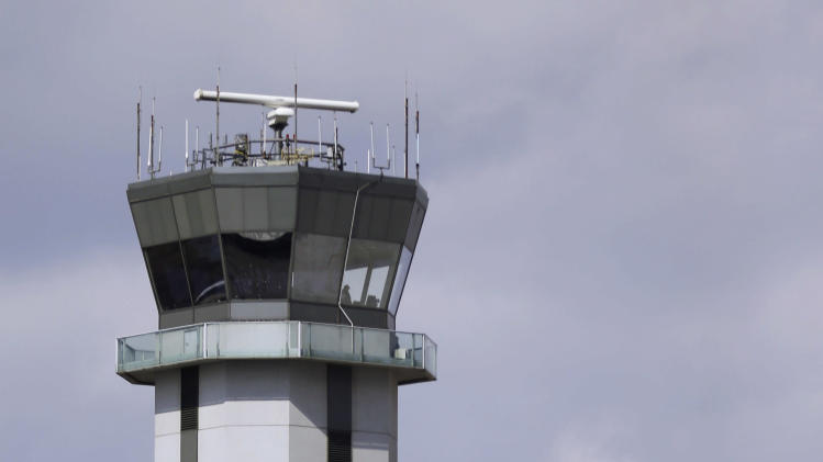 This March 12, 2013 photo shows the air traffic control tower at Chicago's Midway International Airport. Looming federal budget cuts could mean the closure of nearly 240 air traffic control towers at small airports across the country, stripping away an extra layer of safety during takeoffs and landings and leaving many pilots to manage the most critical stages of flight on their own. In addition, overnight shifts could be eliminated at 72 control facilities, including much larger airports such as Midway, which sees an average of 50 overnight flights, nearly all of them operated by Southwest and Delta. (AP Photo/M. Spencer Green)