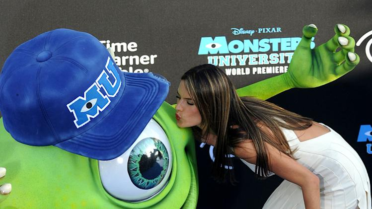 Alessandra Ambrosio kisses monster 'Mike Wazowski' at a Hollywood premiere