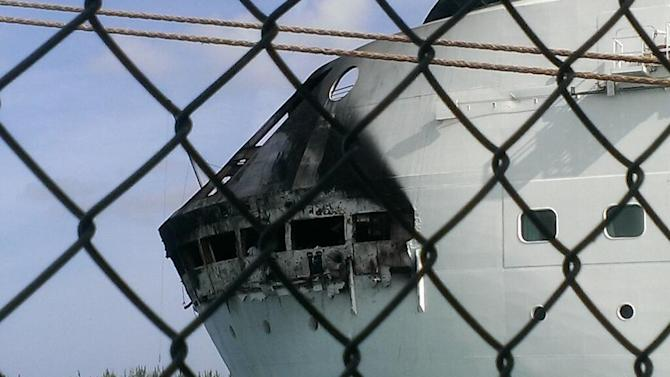 This photo provided by Royal Caribbean shows the fire-damaged exterior of Royal Caribbean's Grandeur of the Seas cruise ship, in Freeport, Bahamas. Royal Caribbean says the fire occurred on the mooring area of Deck 3 about 2:15 a.m. Monday, May 27, 2013, and was quickly extinguished, as the ship was en route to the Bahamas. Passengers and crew members reported to evacuation stations. No injuries were reported. (AP Photo/Royal Caribbean)