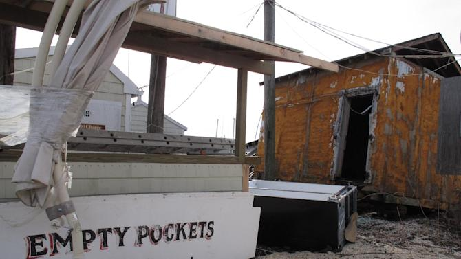 """In this Dec. 12, 2012 photo, a fishing boat named """"Empty Pockets"""" sits in a parking lot in the Belford fishing port in Middletown, N.J. The port sustained nearly $1 million in damages from Superstorm Sandy, some of which its owners hope to recoup through federal storm aid. (AP Photo/Wayne Parry)"""