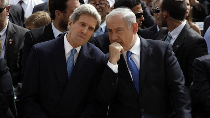 FILE - In this Monday, April 8, 2013 file photo, Israeli Prime Minister Benjamin Netanyahu, right, speaks with U.S. Secretary of State John Kerry during the annual ceremony marking Holocaust Remembrance Day at the Yad Vashem memorial in Jerusalem. On the surface, the Arab League's new peace initiative offers Israel everything it ever dreamed of _ normal relations with an entire region that has long objected to the very existence of the Jewish state, and even the chance to keep some war-won land. But two weeks after Secretary of State John Kerry persuaded Arab leaders to reissue their 2002 offer with new incentives, Israel is maintaining a striking silence and critics are accusing Prime Minister Benjamin Netanyahu of tragically missing a historic opportunity. (AP Photo/Gali Tibbon, Pool)