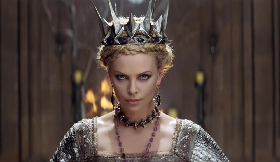 "This film image released by Universal Pictures shows Charlize Theron in a scene from ""Snow White and the Huntsman"". (AP Photo/Universal Pictures)"