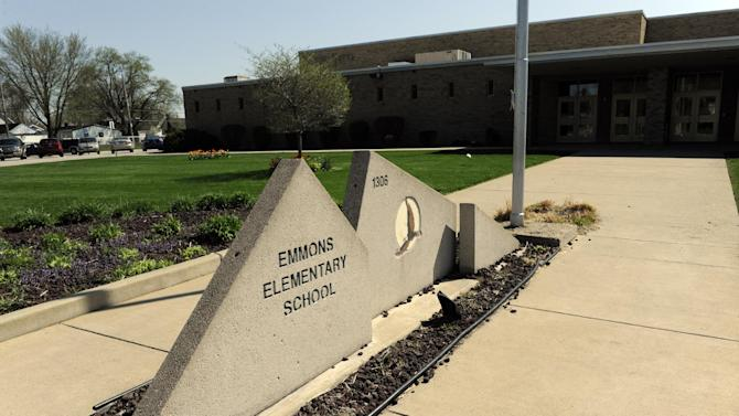 The front of  Emmons Elementary School in Mishawaka, Ind. is shown on Wednesday May 1, 2013. Issues with the computer based testing program have caused some problems with the ISTEP test.  The Indiana Department of Education said in a statement that administration of the ISTEP+ exams' online portion resumed Wednesday morning, but that schools are being asked to decrease their daily test load to 50 percent of normal levels until further notice. (AP Photo/Joe Raymond)