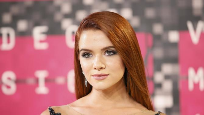 Singer Katie Stevens arrives at the 2015 MTV Video Music Awards in Los Angeles