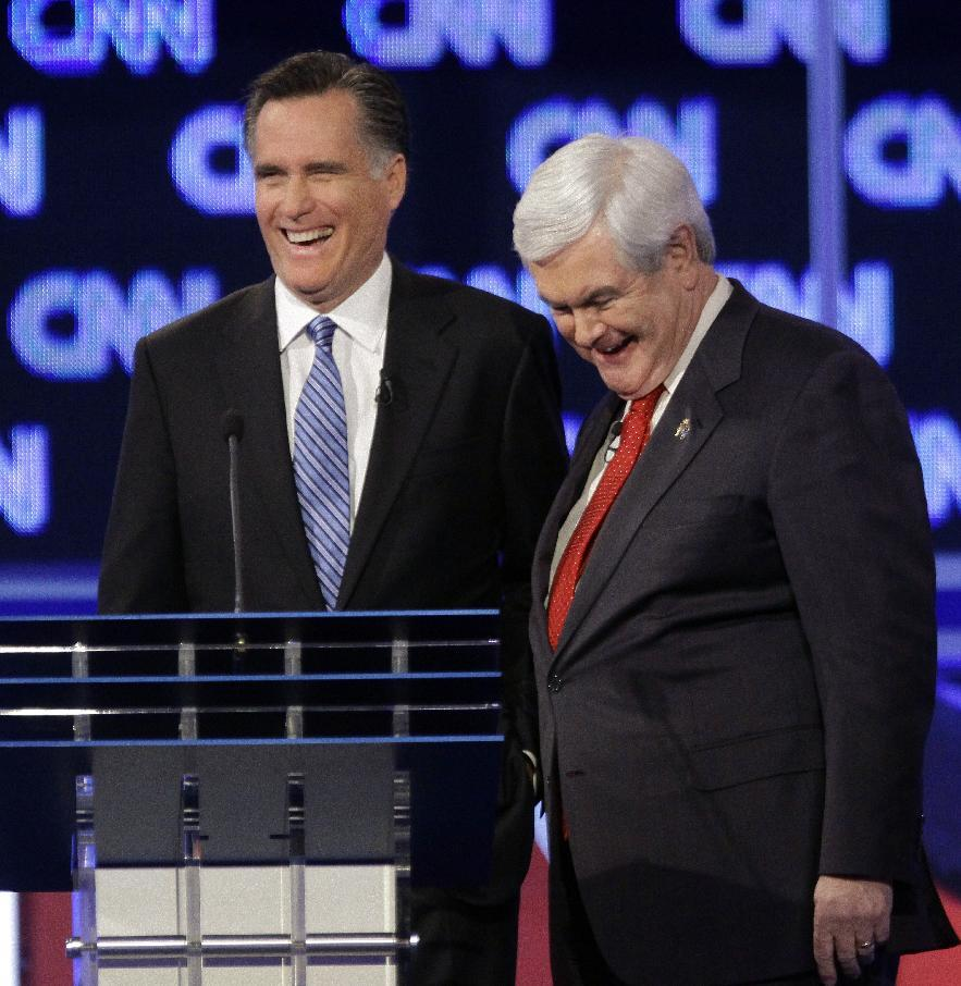 Republican presidential candidates, former Massachusetts Gov. Mitt Romney and former House Speaker Newt Gingrich share a laugh during a commercial break at the Republican presidential candidate debate at the North Charleston Coliseum in Charleston, S.C., Thursday, Jan. 19, 2012. (AP Photo/David Goldman)