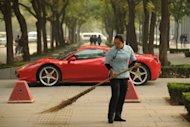 Photo illustration shows a Ferrari parked in Beijing. China's leadership has been hit by a fresh scandal ahead of a 10-yearly power handover, with reports a close ally of the president was demoted following his son's involvement in a fatal Ferrari crash