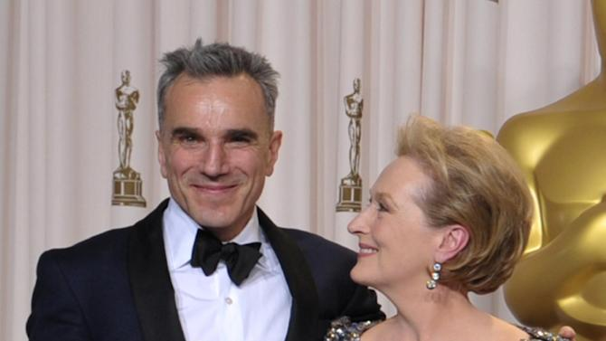 """Daniel Day-Lewis, with his award for best actor in a leading role for """"Lincoln,"""" left, and presenter Meryl Streep pose during the Oscars at the Dolby Theatre on Sunday Feb. 24, 2013, in Los Angeles. (Photo by John Shearer/Invision/AP)"""