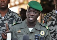 Malian military junta leader captain Amadou Sanogo speaks at Kati military camp near Bamako last month. The group of low-ranking soldiers led by Sanogo which ousted President Amadou Toumani Toure&#39;s government on March 22, last month agreed to the formation of an interim government headed by Dioncounda Traore