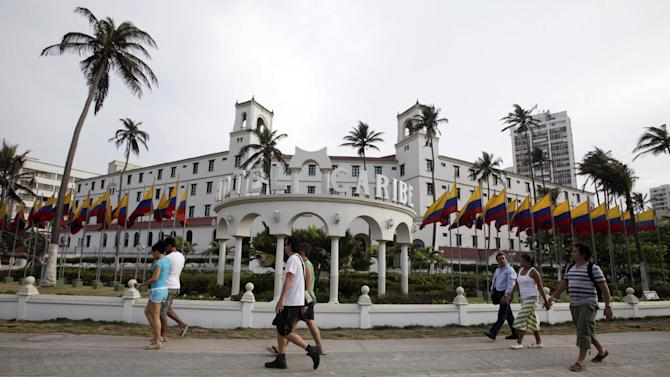 FILE - In this April 14, 2012 file photo, people walk past Hotel El Caribe in Cartagena, Colombia.  The U.S. government has revealed details of serious allegations since 2004 against Secret Service agents and officers, including claims of involvement with prostitutes, leaking sensitive information, publishing pornography, sexual assault, illegal wiretaps, improper use of weapons and drunken behavior. It was not immediately clear how many of the accusations were confirmed to be true.  (AP Photo/Fernando Vergara, File)