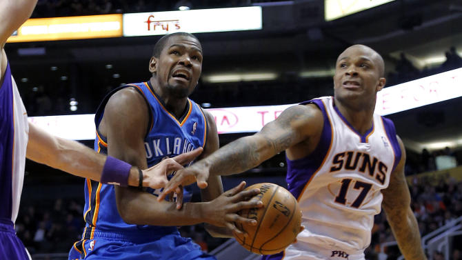 Oklahoma City Thunder forward Kevin Durant is fouled by Phoenix Suns forward P.J. Tucker (17) during the first half of an NBA basketball game, Monday, Jan. 14, 2013, in Phoenix. (AP Photo/Matt York)