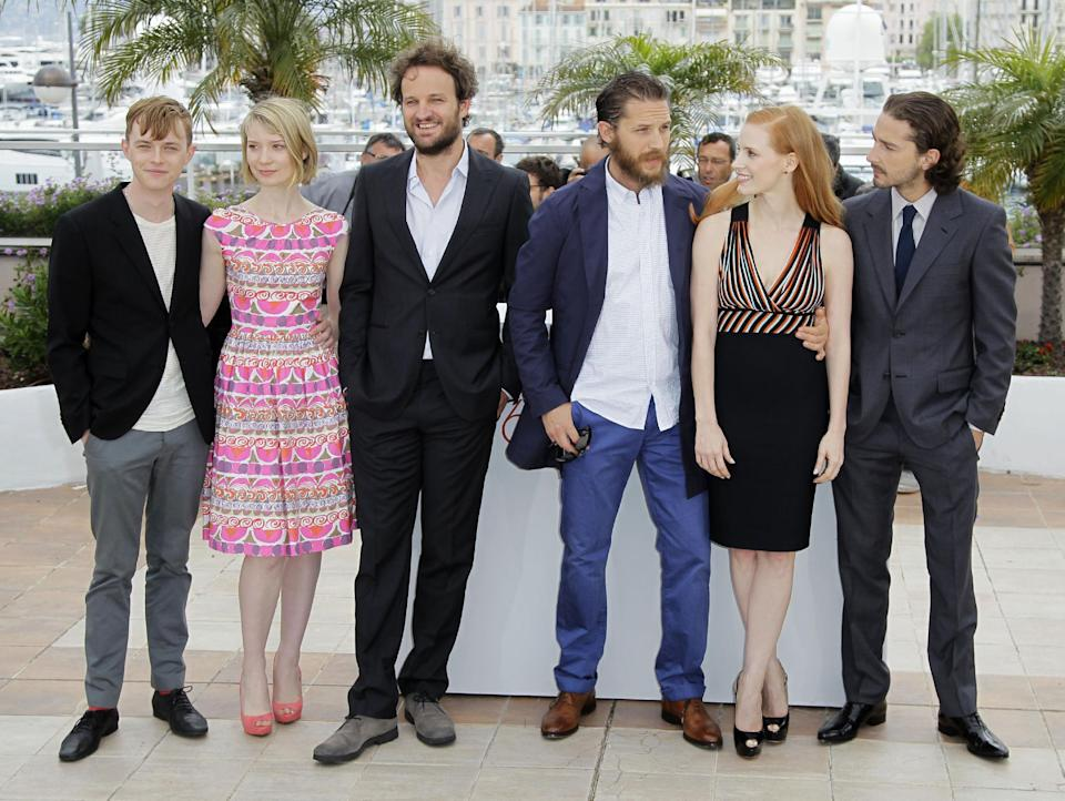 From left actors Dane Dehaan, Mia Wasikowska, Jason Clarke, Tom Hardy, Jessica Chastain and Shia LaBeouf pose during a photo call for Lawless at the 65th international film festival, in Cannes, southern France, Saturday, May 19, 2012. (AP Photo/Francois Mori)
