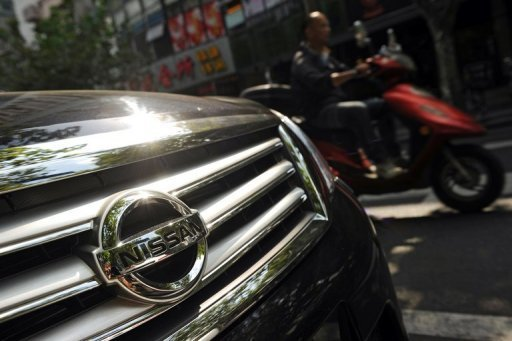 &lt;p&gt;A motorcyclist passes a Nissan car parked on a street in Shanghai in September 2012. Nissan would think twice before making new investments in China, the firm&#39;s chief told the Financial Times, as Japan-brand auto sales dive amid a territorial row between Tokyo and Beijing.&lt;/p&gt;