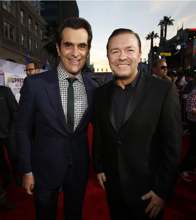 "Cast members Gervais and Burrell pose at the premiere of ""Muppets Most Wanted"" at El Capitan theatre in Hollywood"