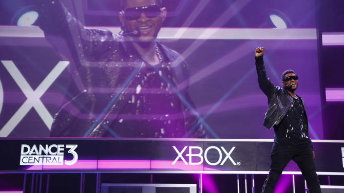 """COMMERCIAL IMAGE - In this image provided by Xbox - Usher performs onstage while debuting """"Dance Central 3"""" at the Xbox 360 E3 media briefing Monday June 4, 2012 in Los Angeles. (Photo by Joe Kohen/Invision for Xbox)"""