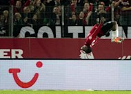 Hanover's striker Mame Diouf celebrates scoring with a cartwheel during the German first division Bundesliga football match Hannover 96 vs Borussia Dortmund in Hannover. The match ended in a 1-1 draw