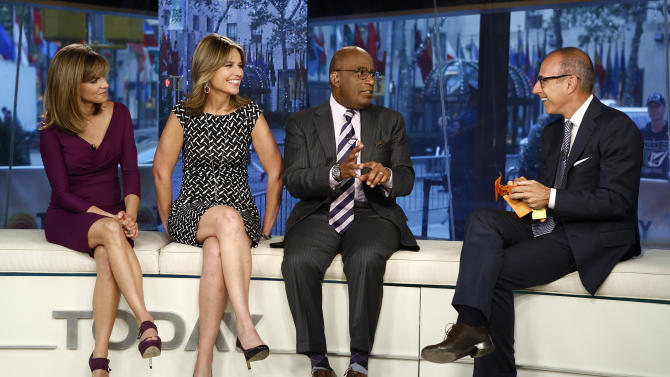 """This Sept. 25, 2012 photo shows """"Today"""" show co-hosts, from left,  Natalie Morales, Savannah Guthrie, Al Roker and Matt Lauer during a broadcast in New York.  The morning show is finding itself on shaky ratings ground. After 15 years at the top, it's been falling behind ABC's """"Good Morning America"""", but remains an advertising magnet. (AP Photo/NBC, Peter Kramer)"""