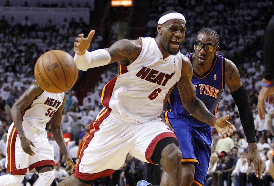 Miami Heat's LeBron James (6) loses control of the ball as New York Knicks' Amare Stoudemire, right, looks on in the first half of an NBA basketball game in the first round of the Eastern Conference playoffs in Miami, Monday, April 30, 2012. (AP Photo/Lynne Sladky)