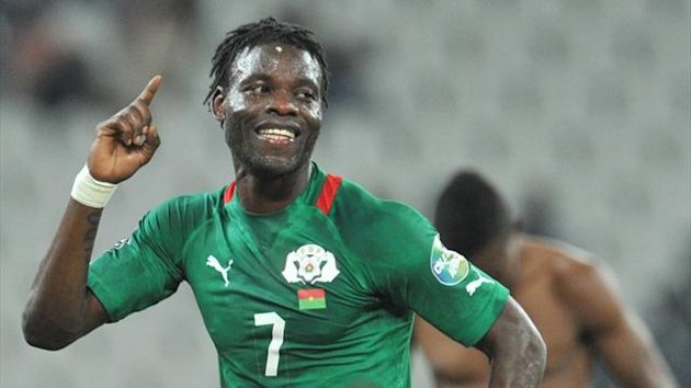Burkina Faso midfielder Florent Rouamba celebrates at the end of the African Cup of Nations quarter-final against Togo (AFP)