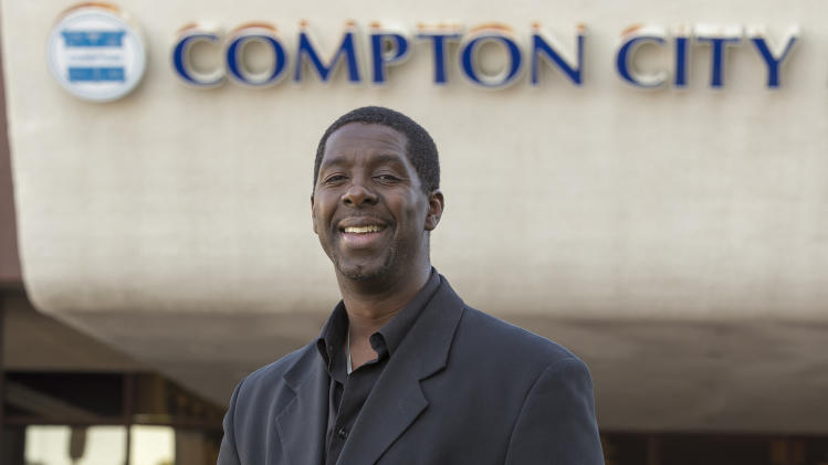 In this photo taken Wednesday, Mar. 13, 2013, former child actor Rodney Allen Rippy poses for a photo outside Compton City Hall in Compton, Calif. Rippy is running for Mayor of Compton in the upcoming April election. (AP Photo/Damian Dovarganes)