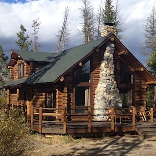 Classic log cabins with stone fireplaces