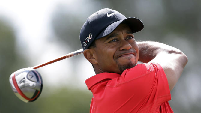 Tiger Woods hits from the third tee during the third round of the Cadillac Championship golf tournament Sunday, March 10, 2013, in Doral, Fla. (AP Photo/Wilfredo Lee)
