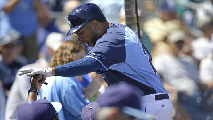 Tampa Bay Rays first baseman James Loney (21) is greeted after scoring on an RBI double by Yunel Escobar during an exhibition baseball game in Port Charlotte, Fla., Tuesday, March 11, 2014. (AP Photo/Gerald Herbert)