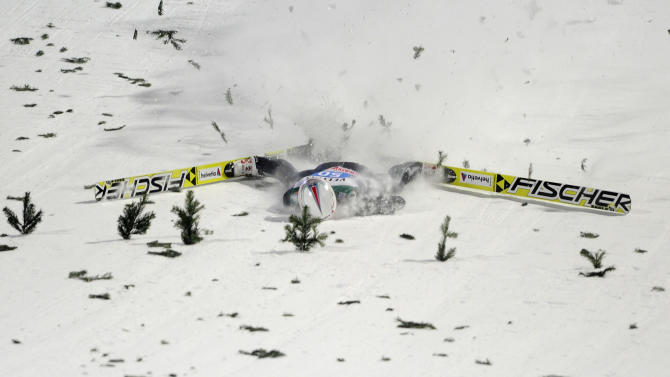 Simon Ammann of Switzerland falls during the final event of the Four Hills tournament of the FIS Ski Jumping World Cup in Bischofshofen on January 6, 2015
