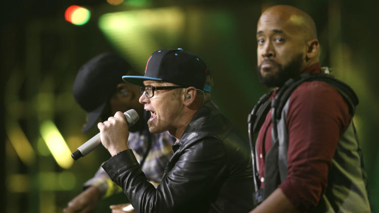 TobyMac, center, performs at the Dove Awards on Tuesday, Oct. 15, 2013, in Nashville, Tenn. (AP Photo/Mark Humphrey)