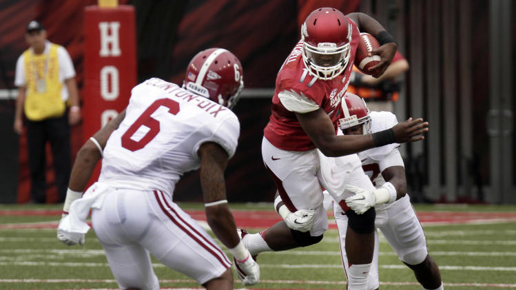 Arkansas quarterback Brandon Mitchell (17) tries to get past Alabama defensive back Ha'Sean Clinton-Dix (6) defensive back Nick Perry during the first quarter of an NCAA college football game in Fayetteville, Ark., Saturday, Sept. 15, 2012. (AP Photo/Danny Johnston)