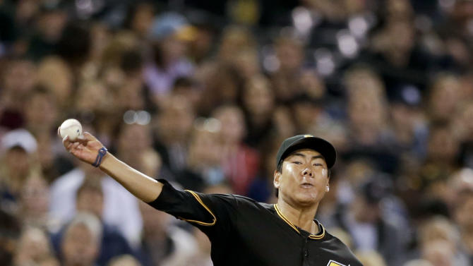 Pittsburgh Pirates third baseman Jung Ho Kang, looks to throw to first as San Diego Padres' Jedd Gyorko slides in safely to third during the fifth inning of a baseball game Friday, May 29, 2015, in San Diego. (AP Photo/Gregory Bull)